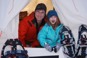 Kyla shows dad, Kevin Callan, how much fun backcountry snowshoe trips can be.