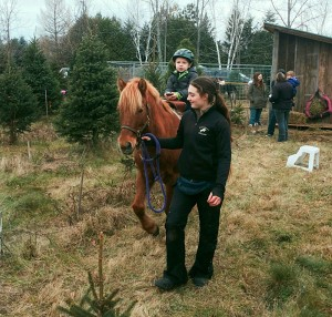 Tree expert and pony whisperer, Julie Barrett, takes some down time at the petting zoo. Don't let her gentle demeanor fool you — she also wields a mean hacksaw.
